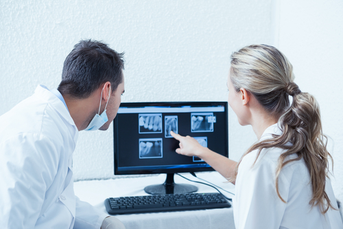 tow dentists viewing x-ray results